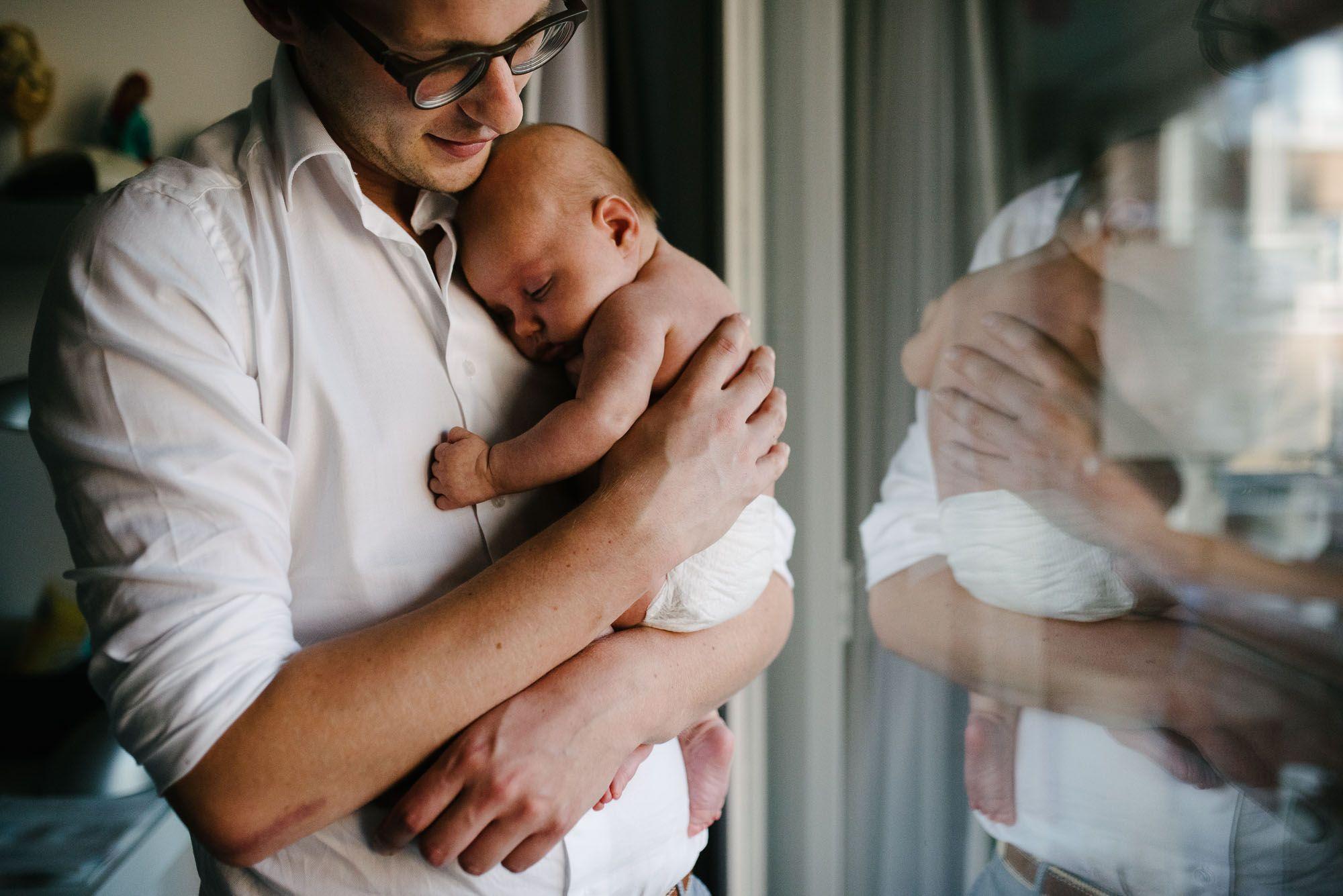 vader met baby newbornfotografie